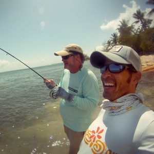 Guide Davin with Client Hooked up to Cayman Bonefish